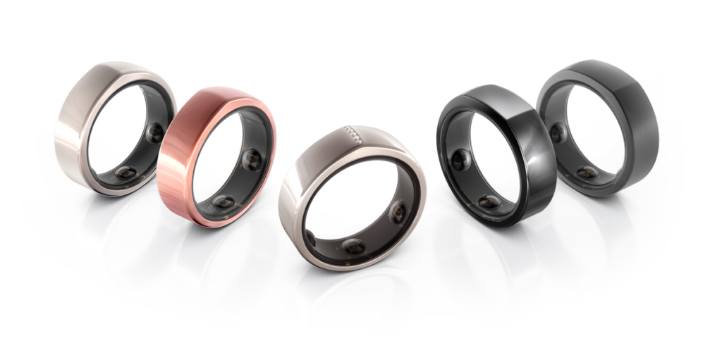 Various Oura smart rings on white background