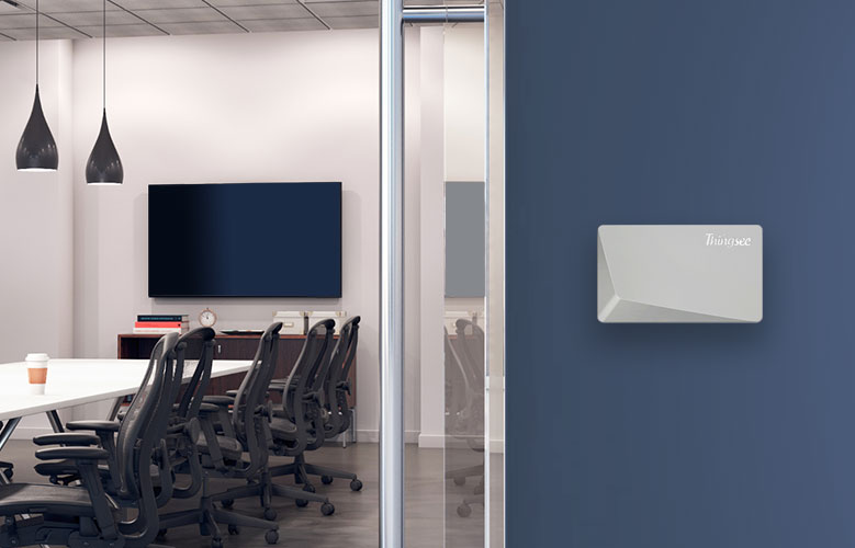 Thingsee AIR sensor mounted on an office wall