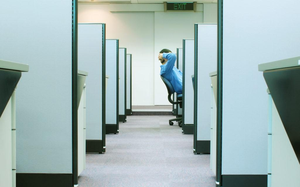 Man sitting in a smart office cubicle