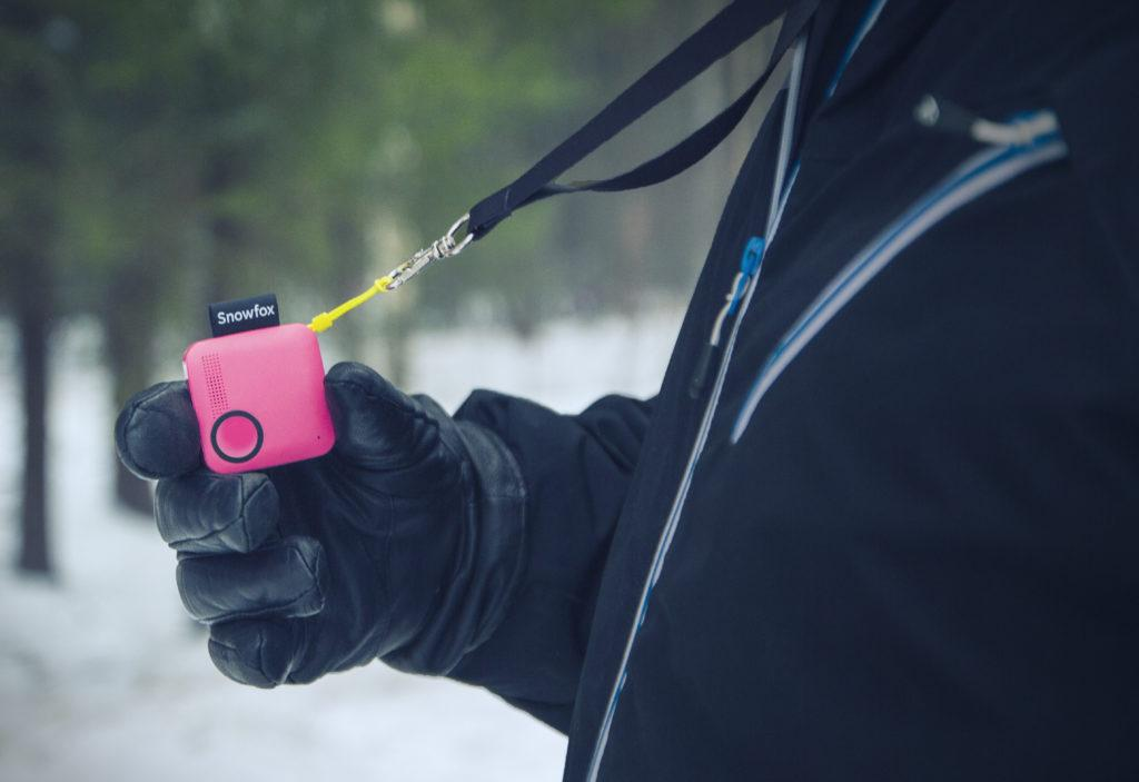 Magenta Snowfox Trackerphone in hand