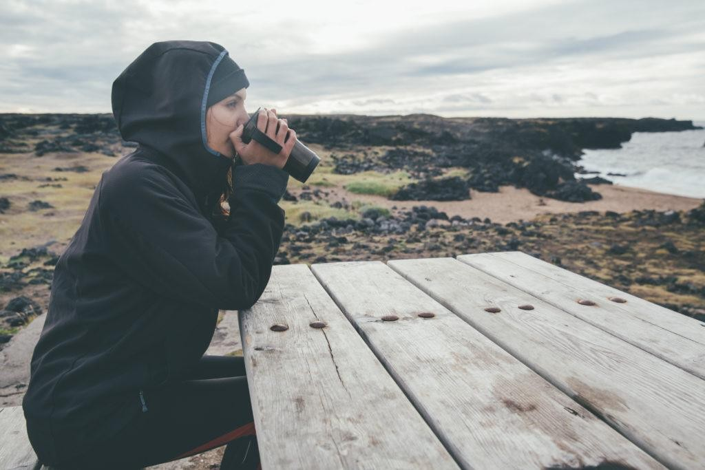 Woman drinking while wearing a Gore jacket