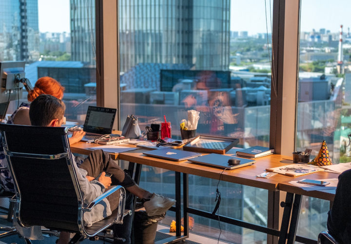 employees in an office with a view, an example of great employee experience