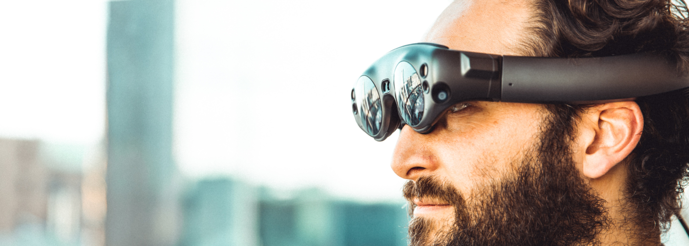 man wearing smart glasses which are one of the product trends